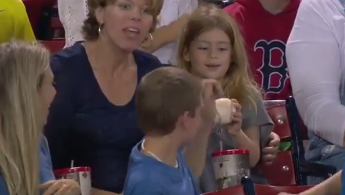 Kind Young Boy Gives Baseball to Girl at a Red Sox Game