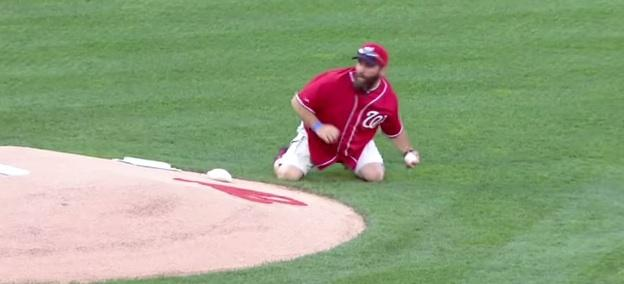 Army vet tosses grenade-style first pitch VIDEO