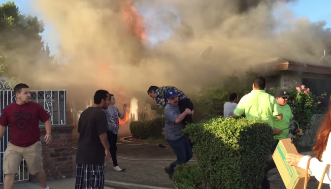 Man rescued from burning Fresno home VIDEO