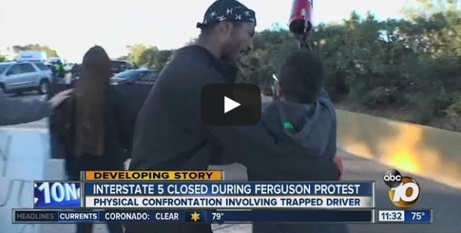 Angry driver pushes student protester on blocked I-5