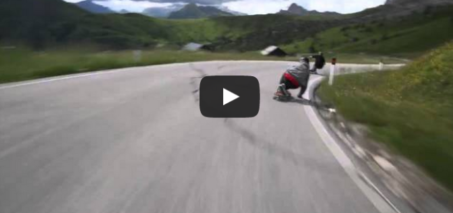 Skateboarders racing cyclists in the ALPS