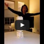 Incredible Jenga move – Girl swipes out the bottom block