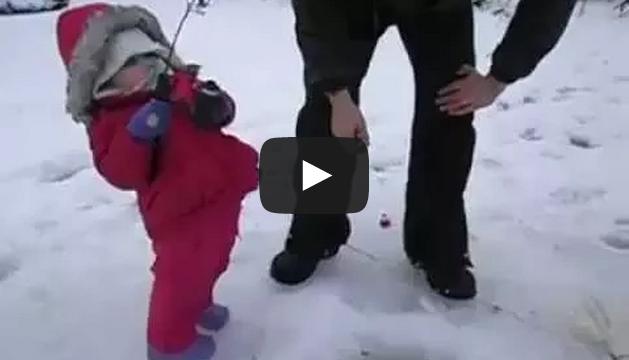 Cute baby girl catches her first fish in Alaska