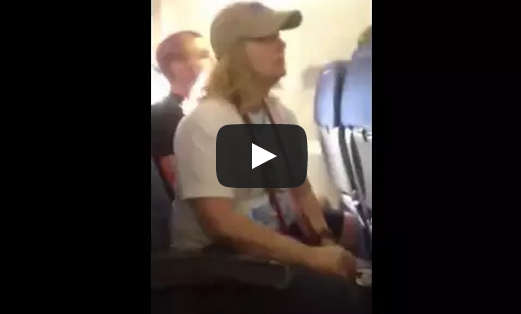 Woman Smokes On A Plane