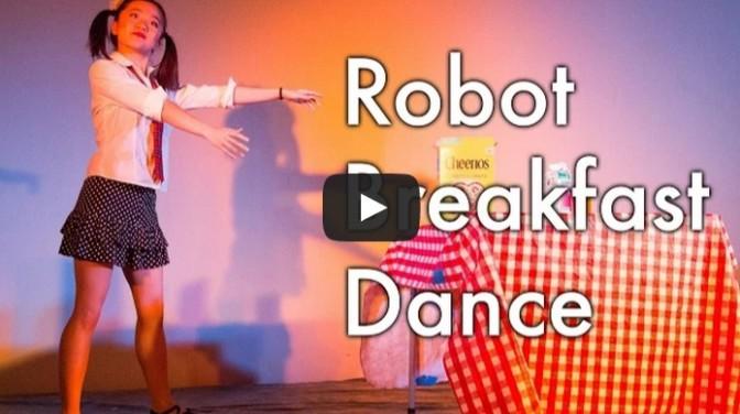 Girl dances like a robot having breakfast