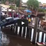 Car boarding a ship over a plank