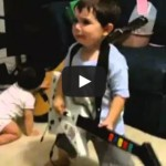 2 year old playing Bulls on Parade on Guitar Hero…..the music takes over.