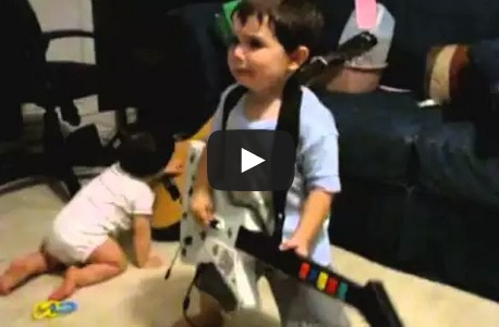2 year old playing Bulls on Parade on Guitar Hero