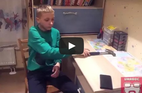 Kid tests his phone case with a hammer and breaks it!