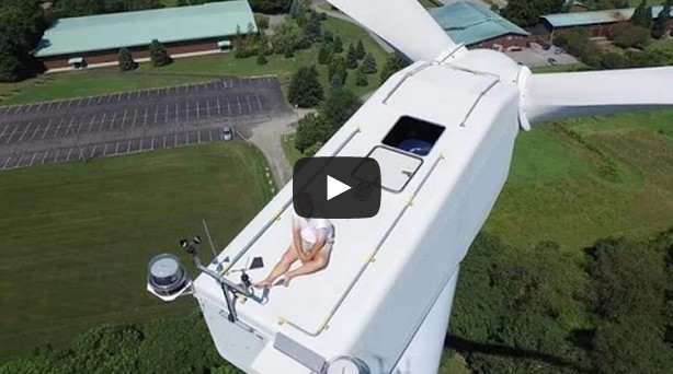 Guy secretly sunbathing on top of wind turbine