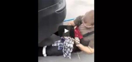 Russian guy blocks car exhaust